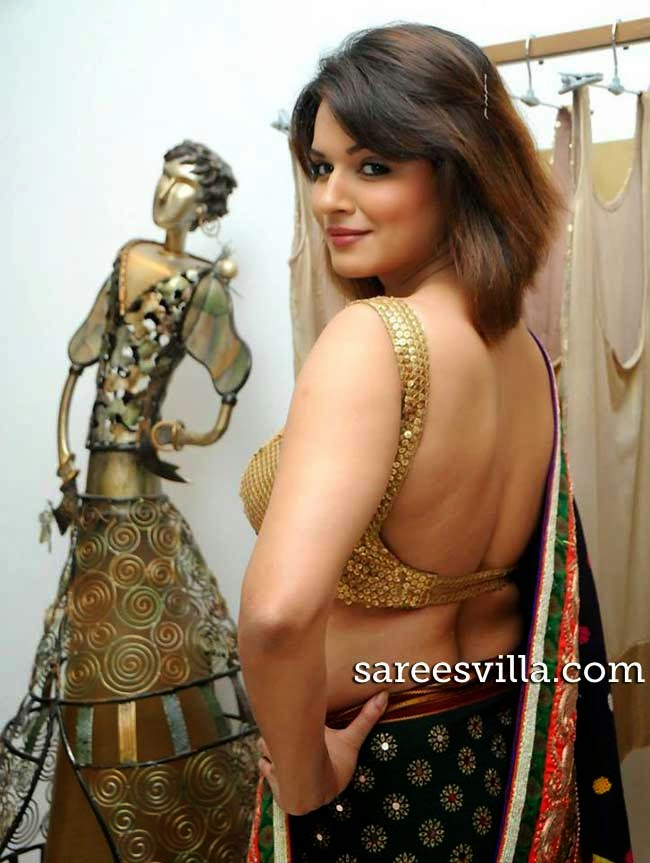 Celeb In Backless Blouse
