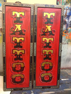 vintage style tattoo panels sign painted by chris dobell of dobell signs canada north america