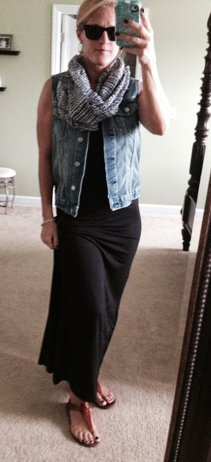black maxi and denim vest