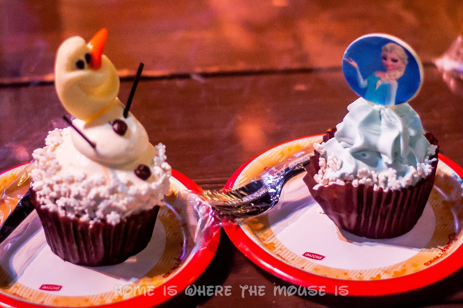 Olaf and Elsa cupcakes.  Wandering Oaken's Frozen Funland