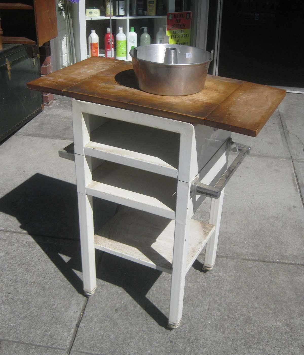 UHURU FURNITURE & COLLECTIBLES SOLD Slender Rolling Kitchen Cart $75