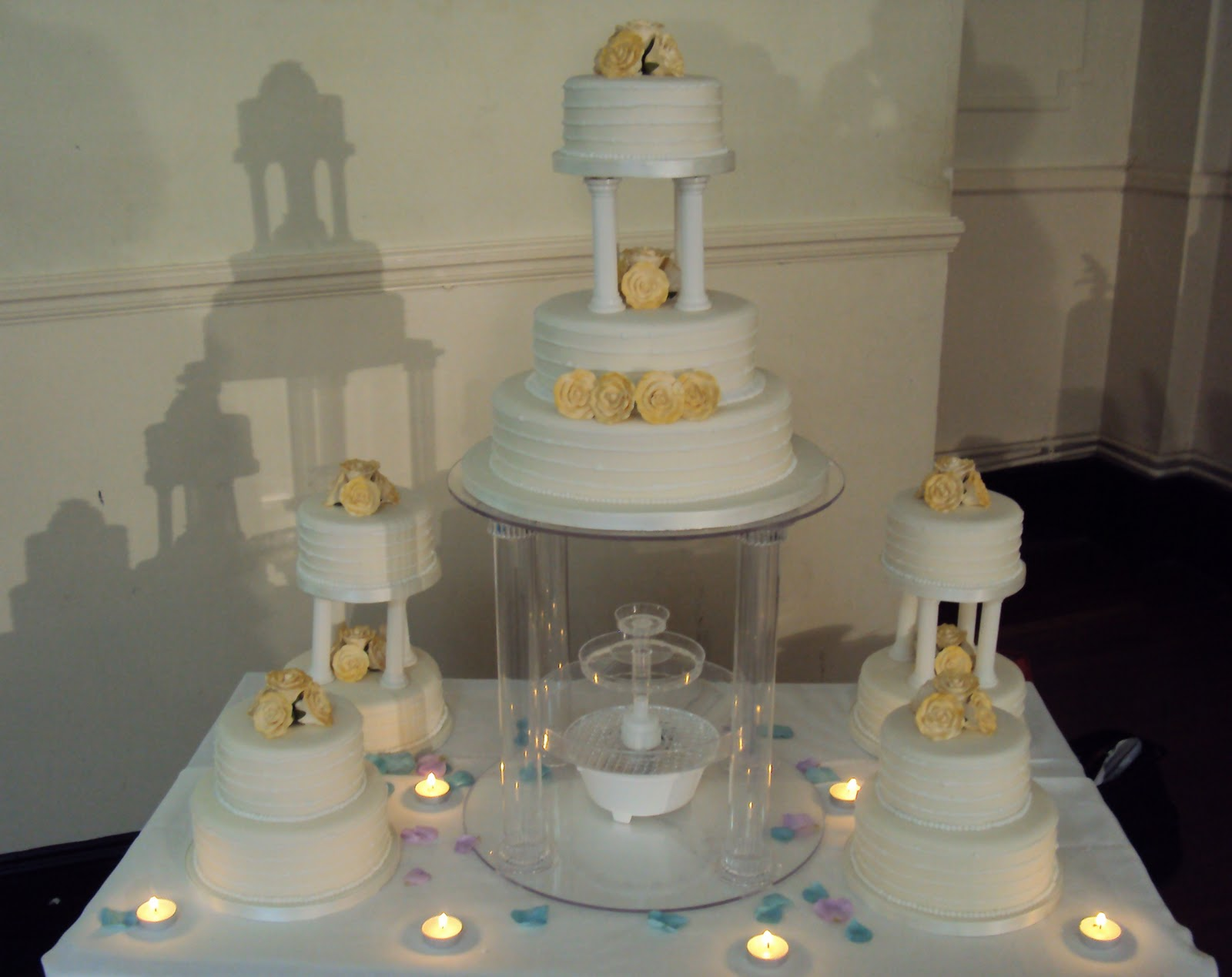 Gold And Ivory Pillar Wedding Cake