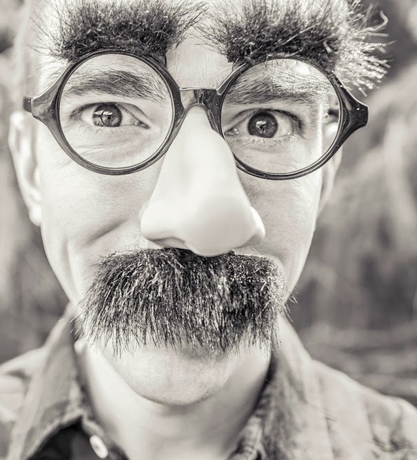 Morgan's Milieu | The First Signs of Puberty: a man with glasses, large moustache and bushy eyebrows.