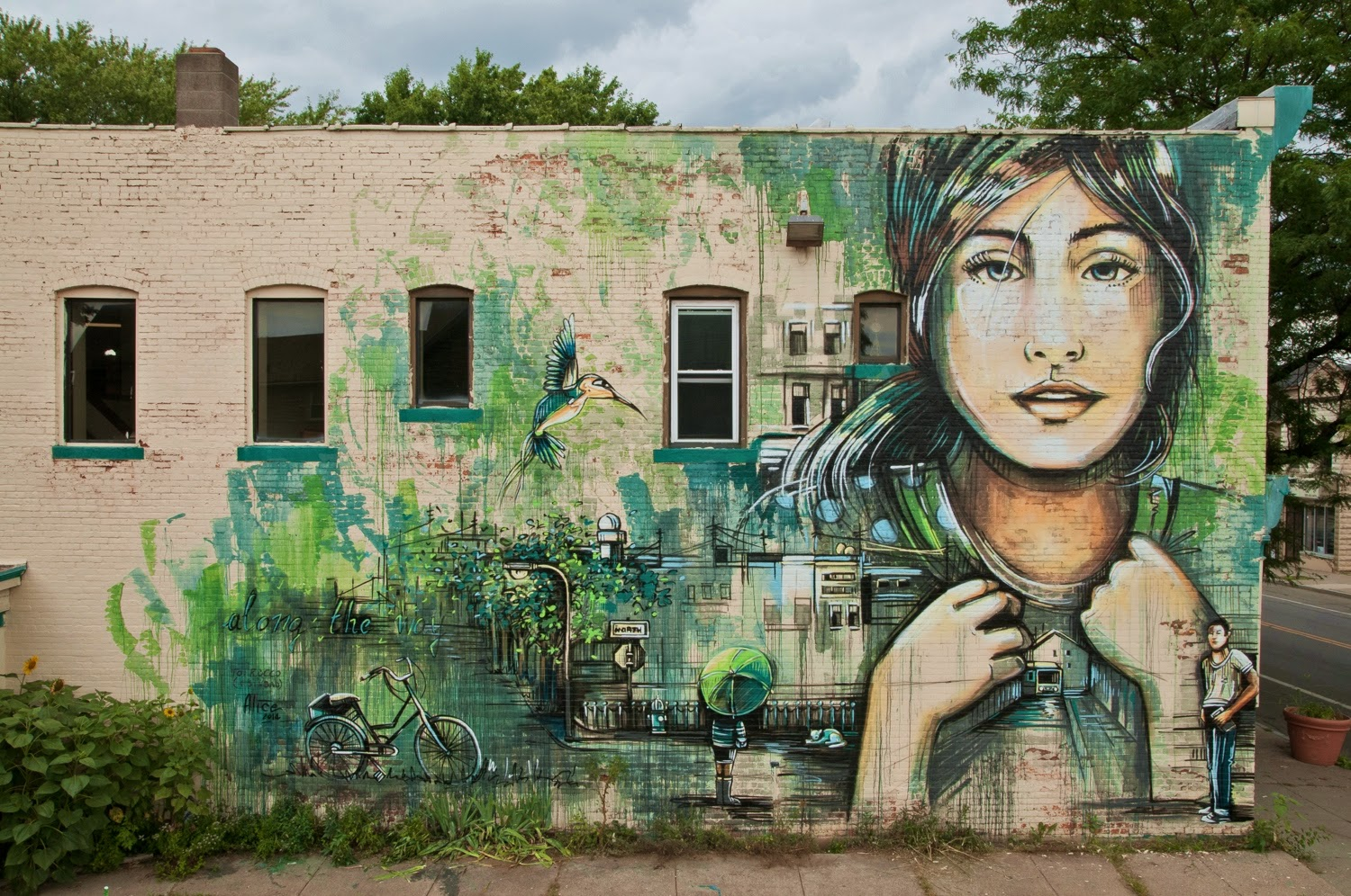 Alice Pasquini was recently in Rochester, USA where she was invited to paint for the newest edition of the always excellent Wall Therapy Street Art Festival.