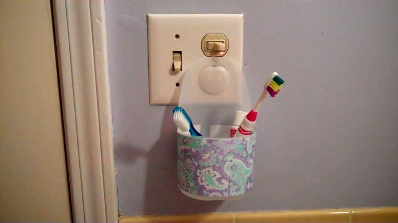 Plastic bottles upcycled into bathroom storage eve of for Homemade items from waste materials
