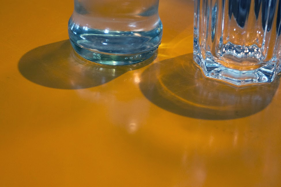 yellow table with glasses