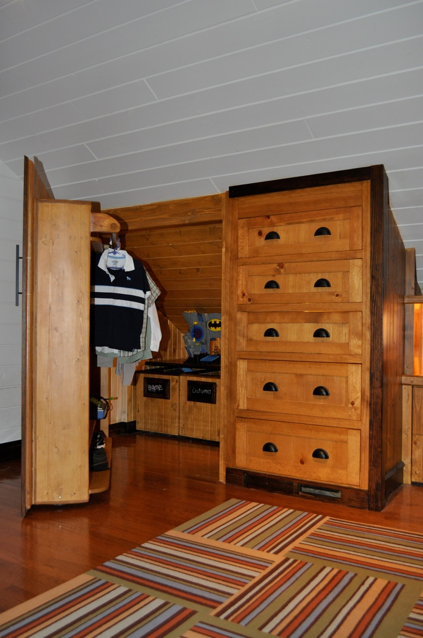 Remodelaholic amazing attic renovation boys bedroom and for Attic bedroom storage