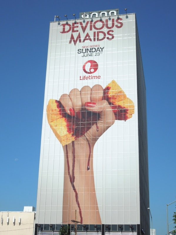 Giant Devious Maids bloody sponge billboard