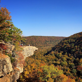 Hawksbill Crag, Arkansas: large stone outcropping over hills covered in fall foliage