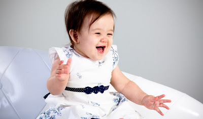 cute baby girl laughing playing picture
