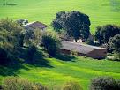 Aproximació fotogràfica a la masia El Verdeguer des del Mirador dels Terressos Blancs
