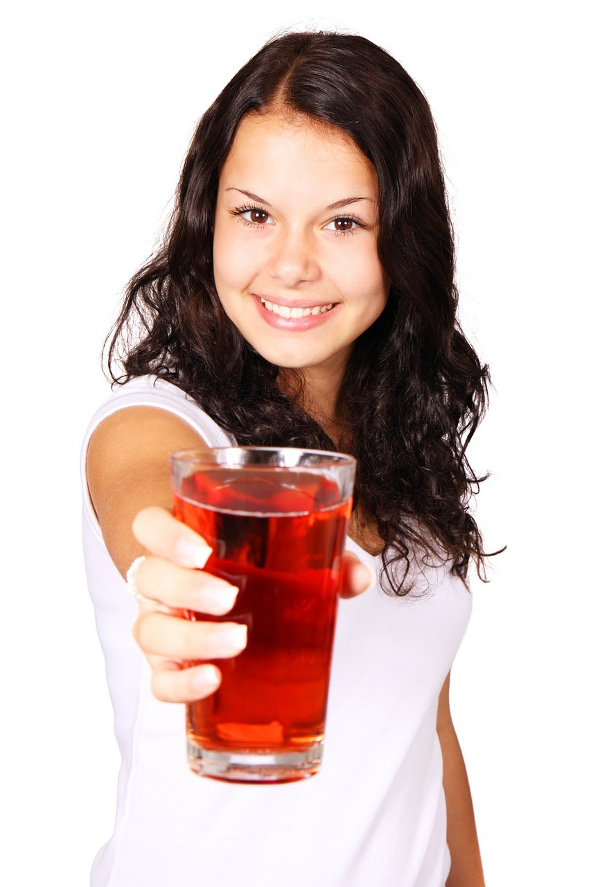 lady with glass of cranberry juice