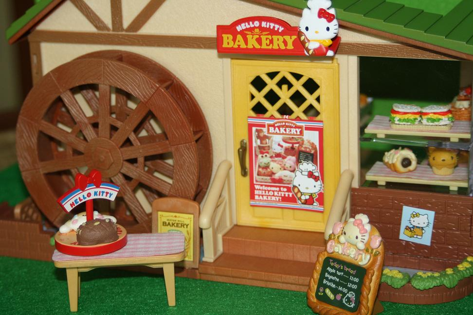 They Have Decorated The Water Mill Bakery With Posters And Pictures A Red Sign Above Door Now Says Hello Kitty