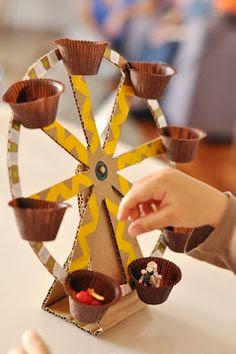 http://www.estefimachado.com.br/2012/08/roda-gigante-de-papelao-os-brinquedos.html