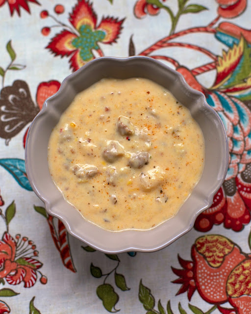 Sausage and Grits Chowder - sausage, potato soup, creamed corn, milk, cajun seasoning, grits and water. Ready in about 15 minutes! SO delicious!
