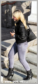 Girl wearing black high heels boots