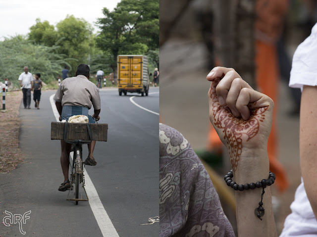 Indian man on bicycle and henna hand