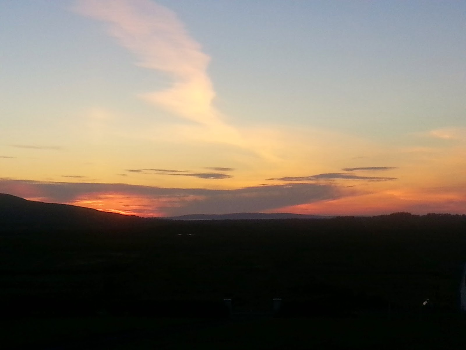summer sunset on achill island, dark in the foreground, ornage, purple, pink and blue sky