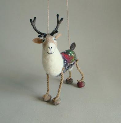 https://www.etsy.com/listing/206650606/anderson-felt-reindeer-art-puppet?ref=favs_view_21&atr_uid=7871404