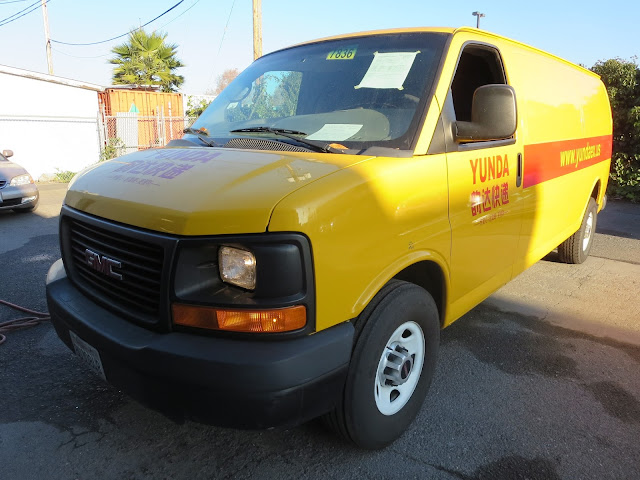 Used truck with previous company's colors and graphics