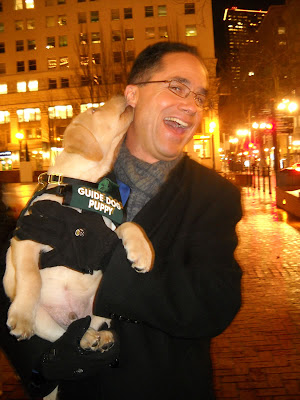 Guide Dog Puppy Zaffino gives KGW-TV Weatherman Matt Zaffino a kiss on the cheek