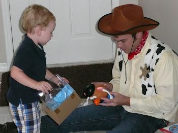 Uncle Chad helping Kaleb open Mr. Potato Head