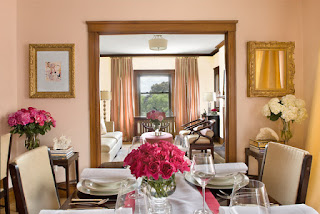 Eclectic Dining Room with Interesting Dining Room Decorating Ideas and Beautiful Flowers in the Glass Vases