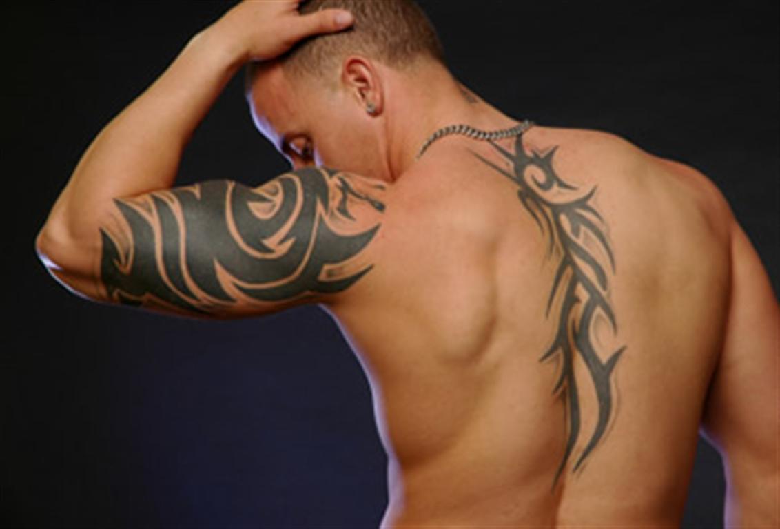 Tattoo art january 2012 for Tribal body tattoo