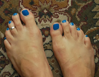 My male painted toes in medium blue called Girls Night Out by Jesses Girl