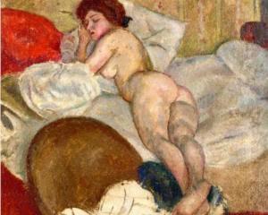 Una muchacha dormida en su casa