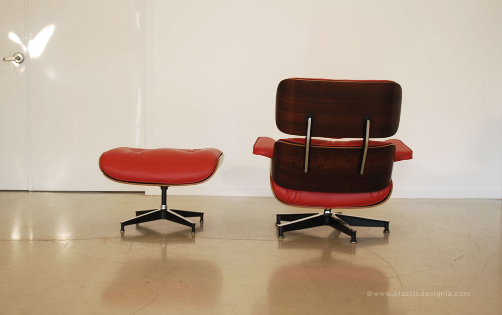 classic design restored eames lounge chair in red leather
