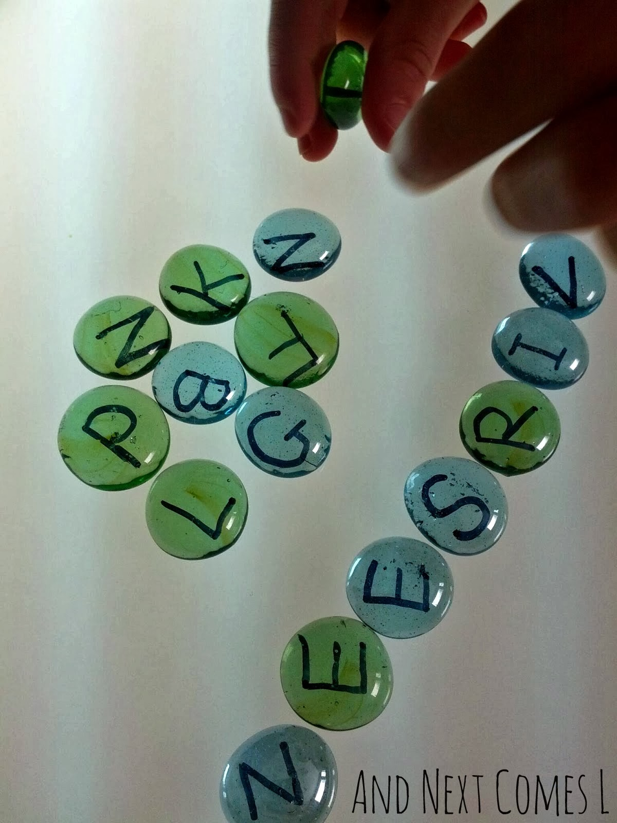 DIY alphabet stones for light table play from And Next Comes L