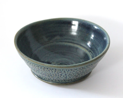 carved and glazed pottery bowl