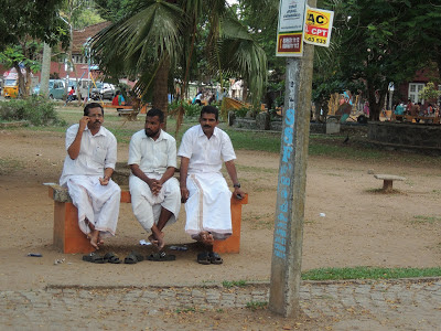 Men clad in Mundu in Kochi