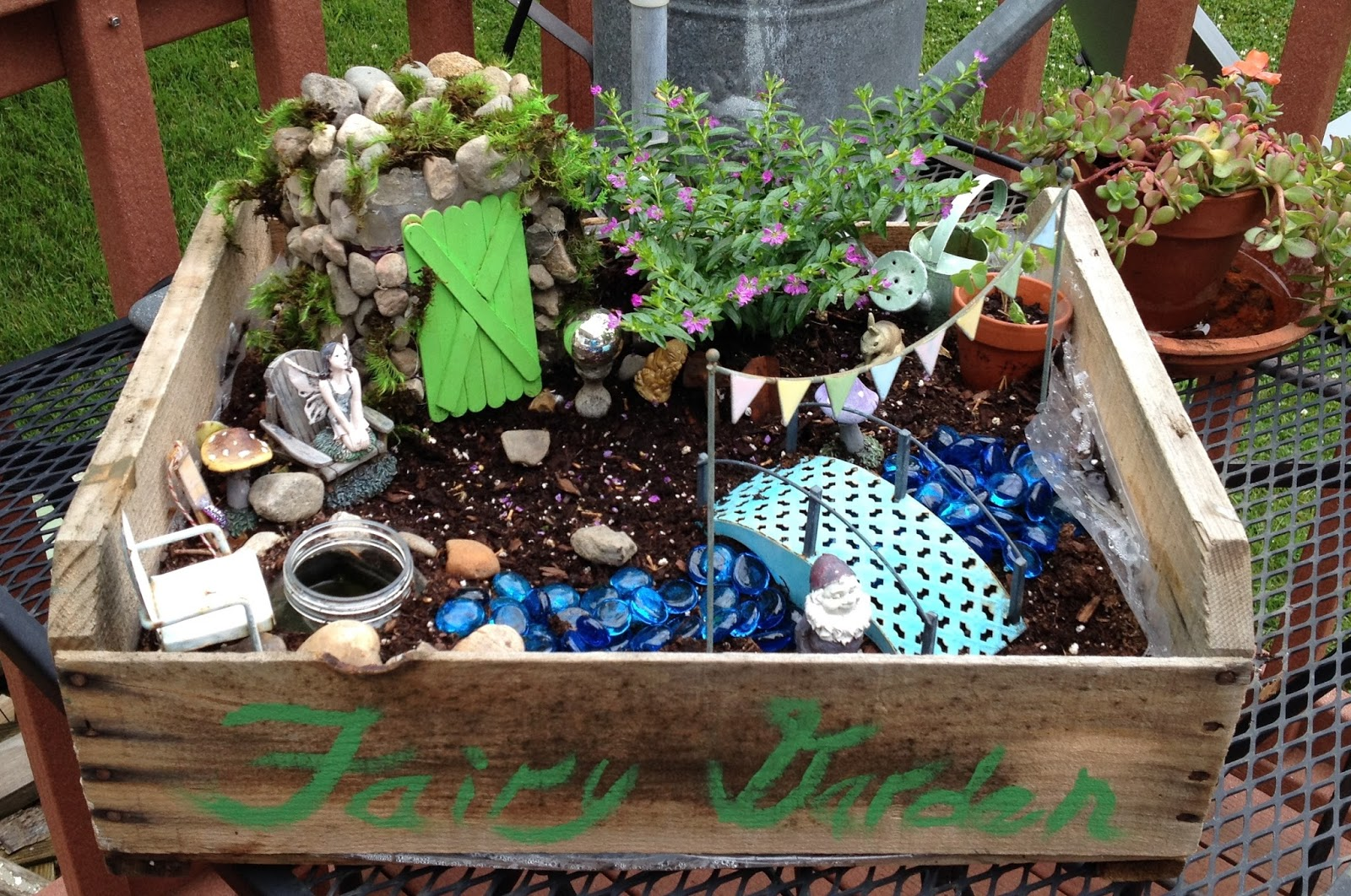 My granddaughter and I made a new fairy garden this year in a smaller  container.