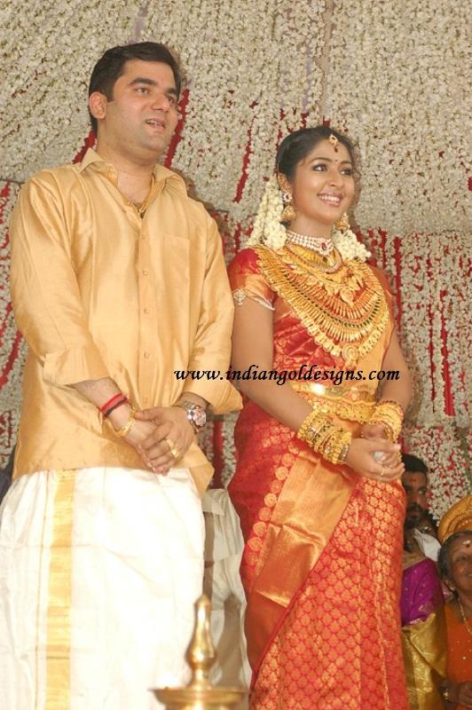 checkout malayalee actress navya nair in heavy kerala gold bridal    Navya Nair Engagement Photos