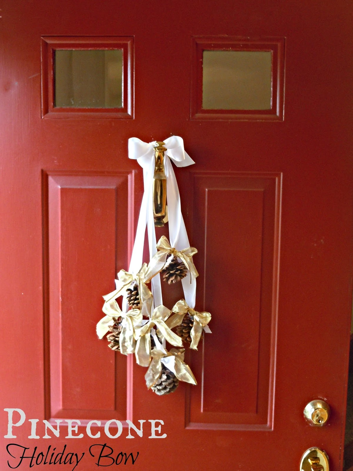 Pine cone holiday bow front door decor life a little for Pine cone door decoration