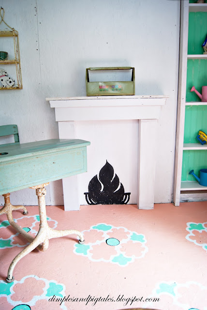 Vintage inspired makeover. Faux Chalkboard fireplace, bookcase and hand painted floors