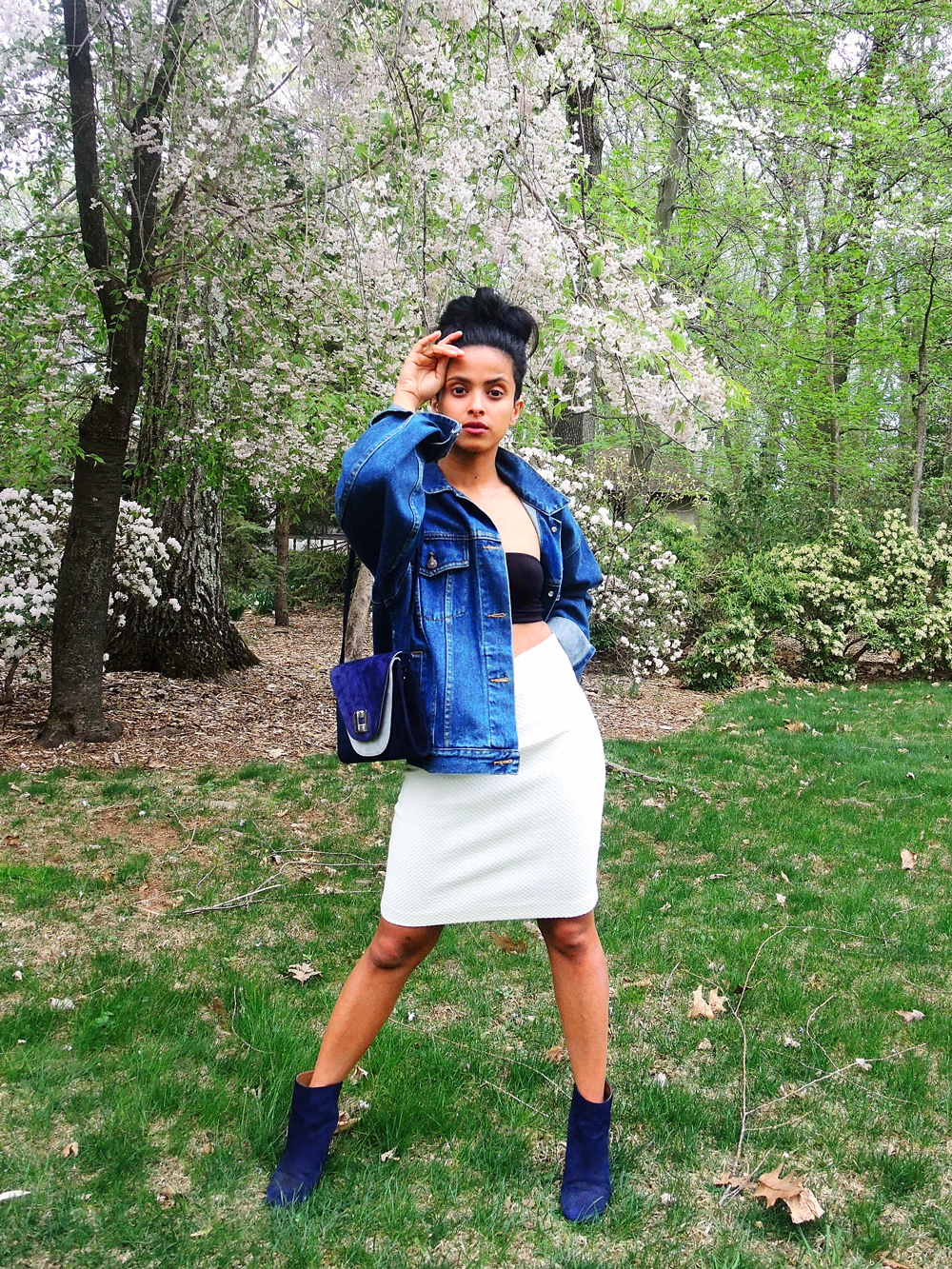 high top messy bun, oversized denim, bandeau top, blue nine west booties, stuart weitzman clutch