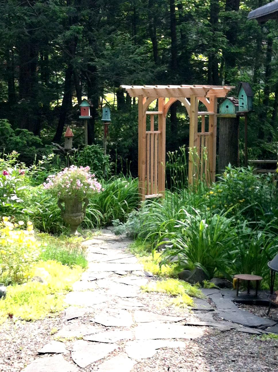 Facci designs the construction of our garden arbor for Garden arbor designs
