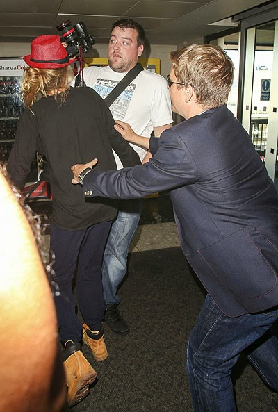 Kara Devlin attacked paparazzi at the airport in London