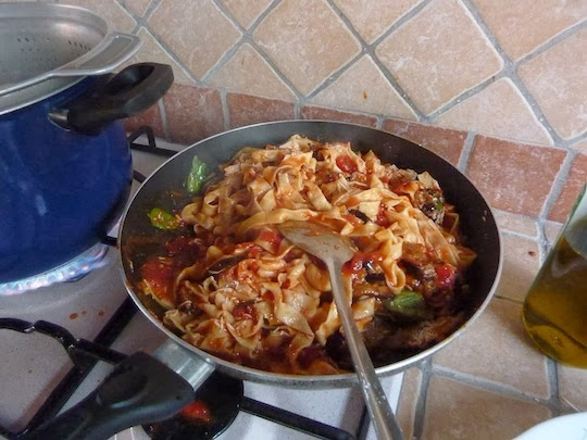 a pan with homemade pasta and sauce