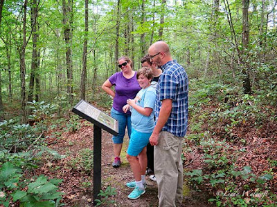 hikers reading sign