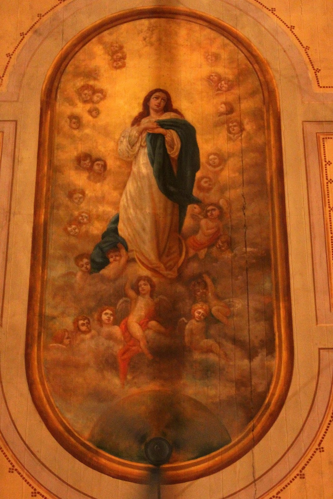 View of Central ceiling mural hovers above the pews