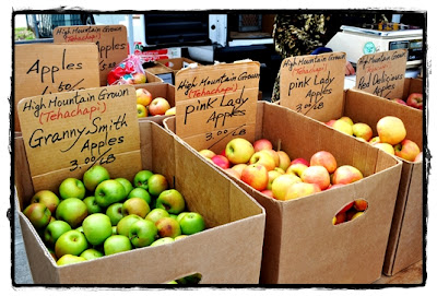 boxes of apples at farmer's market