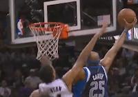 Vince Carter dunks over Tim Duncan