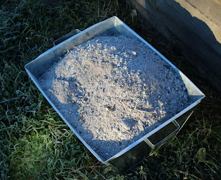 Full bucket of wood ash