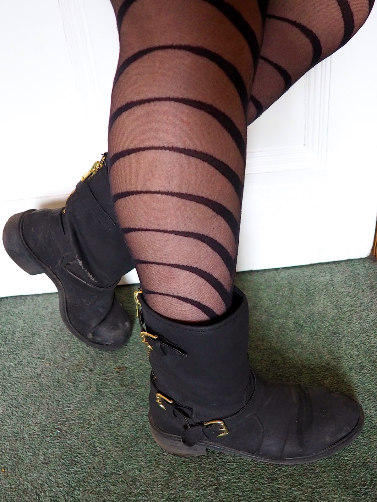 Statement Pieces outfit details | black striped patterned tights and black biker boots