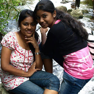 Girls enjoying their vacation in water falls in Tamil Nadu courtallam.
