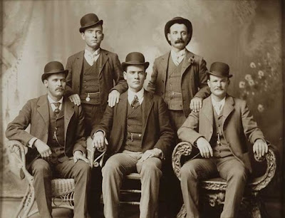 - the wild bunch l to r%2C harry longabaugh %28the sundance kid%29 ben kilpatrick %28the tall texan%29 robert leroy parker %28butch cassidy%29 standing- william todd carver %28bill%29 %26 harvey logan %28kid curry%29 by john swartz ca. 1901